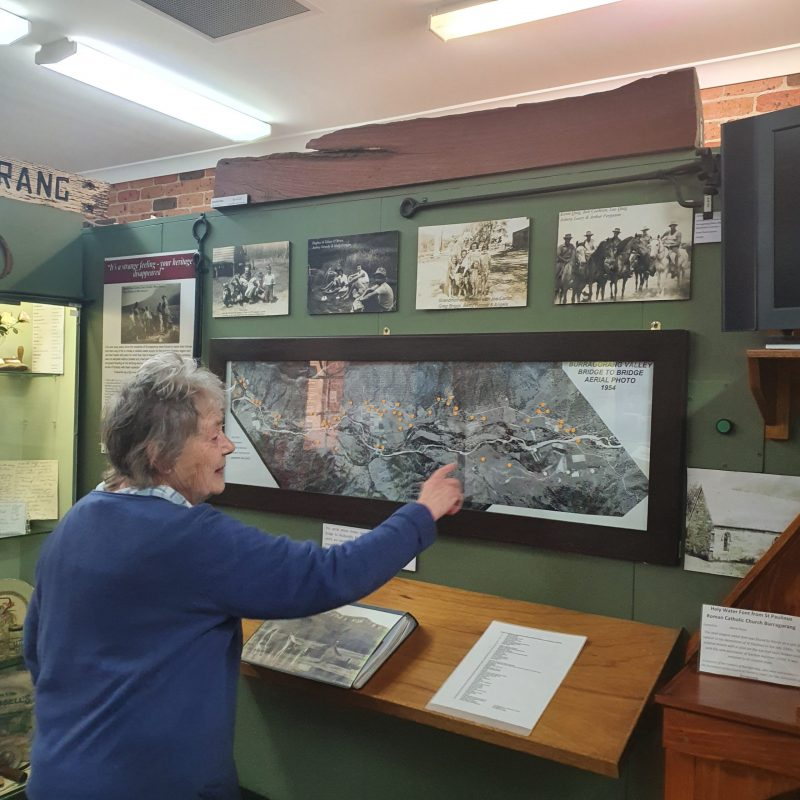 Doreen Lyons points out the location of the Oaks on the 1954 Burragorang Bridge to Bridge aerial photo